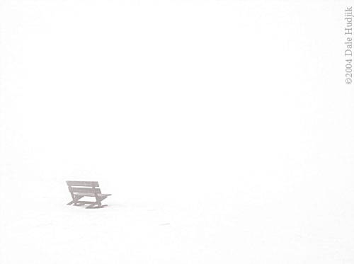 Empty Bench in the Snow