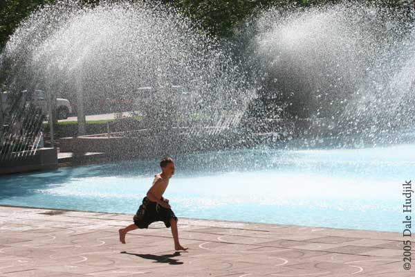Boy Running by City Hall Pool