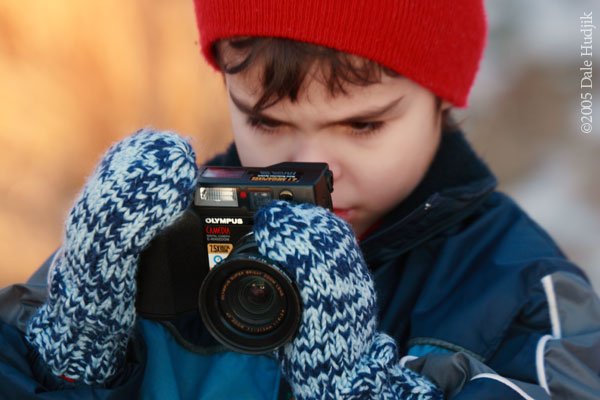 A Young Photographer Concentrating