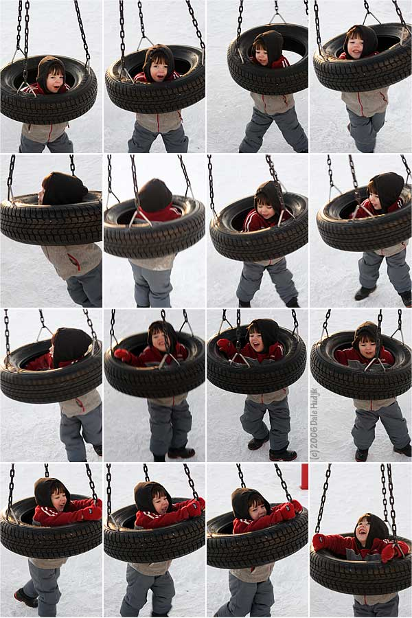little boy on a tire swing