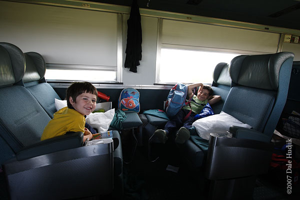 young boys travelling on a train across Canada
