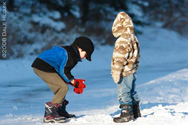 two little boys playing in the snow